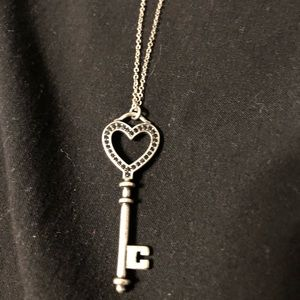 Long necklace with heart shaped key